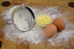 Things used for baking, eggs, butter and flour. Things used for baking in the kitchen, home related. Eggs, butter and flour Stock Images