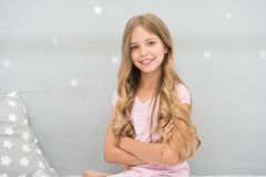 Things you shouldnt do at night if you want healthier hair. How to style hair before go to bed. Girl with long curly. Hair grey background. Hair care tips. Easy royalty free stock photography