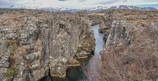 Thingvellir Iceland Rocky Landscape with Snow Covered Mountains. In the Distance Royalty Free Stock Photos