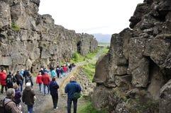 Thingvellir national park. Thingvellir, Iceland - July 25: Tourists visit Thingvellir national park a famous area in Iceland right under the alantic tectonic stock images