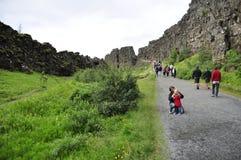 Thingvellir national park. Thingvellir, Iceland - July 25: Tourists visit Thingvellir national park a famous area in Iceland right under the alantic tectonic royalty free stock photo