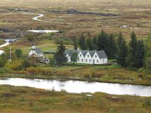 The Thingvellir National Park. At the Thingvellir National Park at Iceland. Some nice buildings. In front of a river. Surrounded by trees Stock Photo