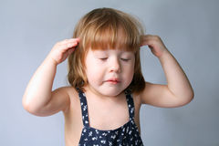 Think. This little girl has an idea about solving a problem Stock Photography