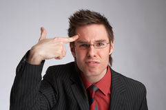 Think. Businessman shows shows  thinking sign Royalty Free Stock Photography