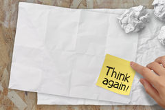 Think again words crumpled sticky note paper on texture paper as Royalty Free Stock Photo