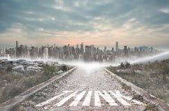 Think against stony path leading to large city on the horizon Stock Image