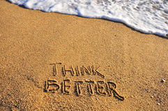 Think better sign on a sand beach Royalty Free Stock Images