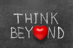 Think beyond chb. Think beyond phrase handwritten on blackboard with heart symbol instead O stock images