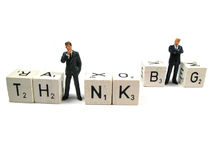 Think big. Two businessmen standing in the word think big stock image