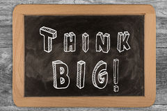 Think big! - chalkboard with  outlined text. On wood Stock Photography