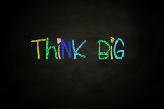 Think Big. Lettering, written with Color Chalk on Blackboard Stock Photos