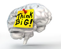 Think big note paper on brain Stock Images