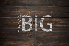 Think BIG phrase handwritten on a wooden old board. Motivation t Royalty Free Stock Photography
