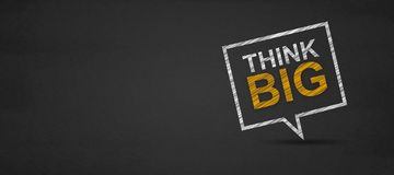 Think big and speech bubble on a blackboard royalty free stock photo
