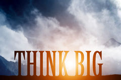 THINK BIG text on mountains landscape. Sunset sky, motivational Royalty Free Stock Photos
