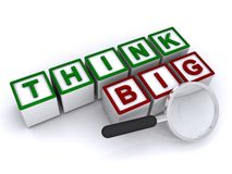 Think big. Thing big graphic in block letters on blocks with magnifying glass on white background Stock Photography