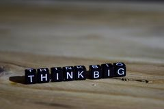 Think big on wooden blocks. Motivation and inspiration concept stock photo