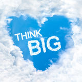 Think big word inside love cloud blue sky only. Think big word inside love cloud heart shape blue sky background only Stock Photography