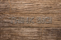 Think Big written on wooden background Stock Photography
