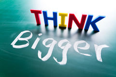 Think bigger concept. Words on blackboard royalty free stock photo