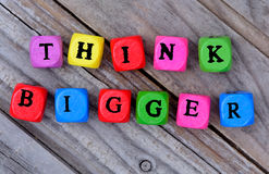 Think bigger words on table Stock Photo