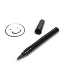 Black pen with smilie face Royalty Free Stock Photo