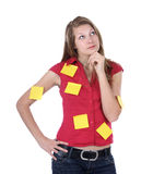 Think busy administrative worker. Think young secretary; woman with adhesive notes think what to do - concept Royalty Free Stock Photo