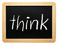Think - chalkboard with text on white background royalty free stock photos