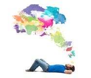 Think creative. Lying boy think creative with colorful splash royalty free stock images
