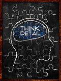 Think Detail Puzzle. On blackboard Stock Photography