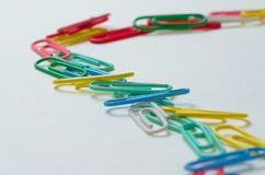 Think different. colored paper clips. Think different, be different. colored paper clips. macro shot. white background stock photos