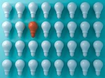 Think different concept One orange light bulb standing out from the white light bulbs on blue pastel color. Wall background leadership and individuality vector illustration