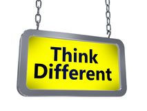 Think different on billboard. Think different yellow light box billboard on white background Royalty Free Stock Photos