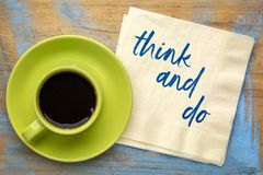 Think and do concept on napkin royalty free stock photos
