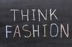 Think fashion. Phrase handwritten on the school blackboard Stock Photography