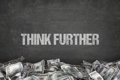 Think further text on black background royalty free stock photo
