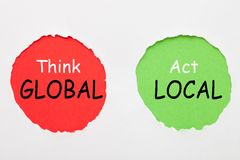 Think Global Act Local. Think Global and Act Local text in red and green circles on white background. Business concept royalty free stock photos