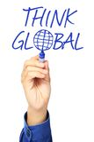 Think Global. A hand writing Think Global on a whiteboard stock image