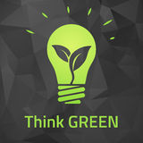 Think green eco bulb on dark origamei background Royalty Free Stock Photography