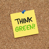 THINK GREEN. Note pinned on cork noticeboard Stock Photo