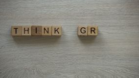 Think green phrase made of cubes, woman holding plant in hands, greenhouse gases. Stock footage stock footage