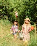 Think green. small girls farmer in village. children hold gardening tools. earth day. summer family farm. farming and
