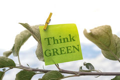 Think Green. On sticky note concept Royalty Free Stock Photography