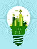 Go green city idea concept. Think green text. Lamp and green city town background. Vector file layered for easy manipulation and custom coloring Royalty Free Stock Images