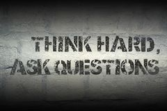 Think hard, ask gr. Think hard, ask questions stencil print on the grunge white brick wall Stock Photos