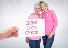 Think Look Check Text and Hand holding card with pink breast cancer awareness women Royalty Free Stock Photos