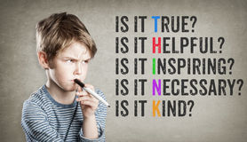 Think motivational netiquette, Boy on grunge background royalty free stock photos