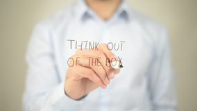 Think Out of the Box,  Man writing on transparent screen Royalty Free Stock Photo
