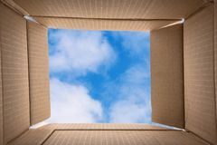 Think Out of the Box. Think Outside the Box. Conceptual Image about Creative thinking consisting of a photo of the inside of an Open Cardboard Box with a Blue Royalty Free Stock Images