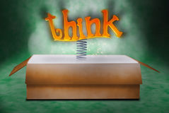 Think Outside the Box. The word think spring from a box Royalty Free Stock Photo